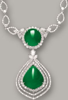 JADEITE AND DIAMOND NECKLACE Suspending to the front a pear-shaped and oval jadeite cabochon of translucent emerald green colour, decorated by pear-shaped and brilliant-cut diamonds together weighing approximately 5.50 carats, mounted in 18 karat white gold, length approximately 400mm. Pear-shaped cabochon approximately 17.76 x 14.92 x 6.68mm; oval cabochon approximately 13.13 x 12.45 x 4.25mm.