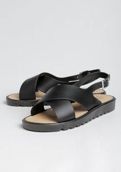 Hit the town in these ultra-comfy black faux leather sandals featuring an open-toe design with thick crisscross front straps and an ankle strap with an adjustable silver-toned buckle.