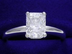 Diamond ring with 1.10 carat cut cornered rectangular brilliant (radiant) cut diamond graded E color, VS2 clarity, depth 68.4 %, table 65 %, Very Good, Very Good symmetry, No fluorescence, measuring 6.99 x 5.32 x 3.64 mm (ref: GIA 16225043, laser inscribed, dated 08/10/2007) set in a 14-karat white gold (Stamped 14K) Solitaire style mounting with a four-prong basket head. The ring measures 2.5 millimeters wide.