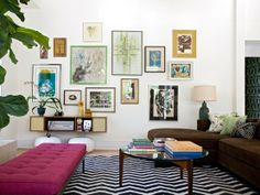 Dood- I love this wall collage, patterned rug, pillows, accessories... just really good.