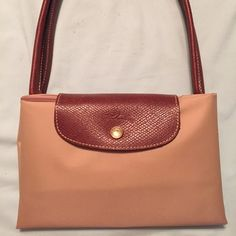 Early wknd SALEAuthentic longchamp Authentic tan colored long handle longchamp Eiffel Tower design. Like new condition. Used it only twice! This is the large size. Longchamp Bags