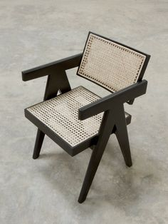 A handcrafted re-edition of the Pierre Jeanneret Office Cane Chair by Phantom Hands, made with Burma teak and stained black to give it a dark matte finish. Pierre Jeanneret, Black Armchair, Rattan Armchair, Black Rattan Chair, Armchair Table, French Armchair, Wooden Armchair, Armchair Slipcover, Velvet Armchair