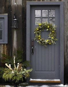 A gray door has a way of balancing a bright exterior and lending just the right amount of steely modernity to more traditional structures.