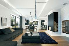 eclairage-led-indirect-salon-spacieux-mur-brique-blanche-lustre éclairage led indirect