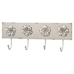 "Wall rack in white with 4 metal hooks and rosette details.    Product: Wall rackConstruction Material: MDF and metalColor: WhiteFeatures: Warmly weathered finishDimensions: 6"" H x 16"" W x 2.5"" D"