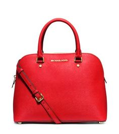 Talk about a high-style satchel, the Cindy is one chic and streamlined design. Offering up a structured silhouette and spacious interior, this versatile piece features a detachable shoulder strap and is crafted from our signature Saffiano leather. Add daytime elegance to your accessories repertoire with this polished piece.