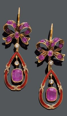 A PAIR OF ANTIQUE ENAMEL, RUBY AND DIAMOND EAR PENDANTS, ca. 1900. Each set with an oval Burmese ruby within a pear-shaped enamelled gold frame, surmounted by rose-cut diamonds and a ruby-set bow motif, mounted in yellow gold. #antique #earrings