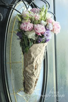 A chicken wire flower basket: You need chicken wire shaped to how you would like (cone, square, etc)  brown paper or your choice of paper to wrap around the bouquet a little jar or plastic cup to tuck inside for water for the flowers.