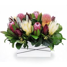 Outback - deluxe trough arrangement of mixed long-lasting Australian natives blooms. Tropical Flower Arrangements, Modern Floral Arrangements, Artificial Floral Arrangements, Floral Centerpieces, Tropical Flowers, Protea Flower, Australian Native Flowers, Corporate Flowers, Flower Studio