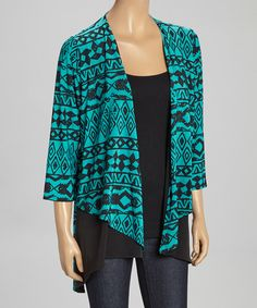 Cardigans+are+a+well-loved+style+staple+because+of+their+comfort+and+versatility.+This+version's+bold+print+and+stretch+fit+provide+an+extra-cozy+touch+to+a+classic+piece.+In+addition,+black+side+panels+give+it+added+length.