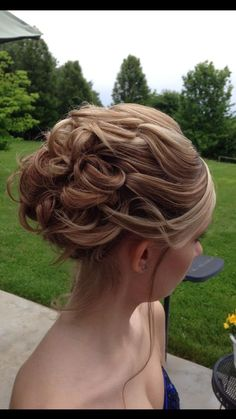 Updo with Kenra Platinum Hot Spray 20 and Kenra Volume Spray 25. Work by stylist Julie Mohr from Maryland.
