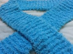 This gorgeous light blue fluffy fleece scarf is perfect for adding a little dash of colour to an outfit, and keep your neck warm while doing