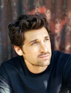 McDreamy...handsome beyond words and from what you can see, a devoted husband and loving father, which just makes him that much more handsome.