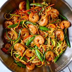"""""""Asian Zucchini Noodle Stir-Fry with Shrimp Follow @justataste Ingredients: 1/2 cup chicken or vegetable broth 1/4 cup hoisin sauce 1 Tablespoon low sodium soy sauce 2 teaspoons cornstarch 3 Tablespoons olive oil, divided 1 Tablespoon minced garlic 1 teaspoon minced fresh ginger 1 pound jumbo shrimp, shelled and deveined 1 medium bell pepper, sliced 1/2 cup shredded carrots 2/3 cup sliced red onions 1 cup sugar snap peas 2 medium zucchini, cut into noodles (See Kelly's Note) Toasted sesame…"""
