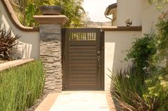 Custom Wood Gates by Garden Passages Premium Wood Gates  Features: Horizontal Body with Metal Picket Premium Stain Thick Body Emtek Hardware Heavy Duty Hinges  See More at: http://www.gardenpassages.com/premium-wood-gates