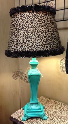 """Hand painted (by me) turquoise lamp """"distressed"""" with brown stain, with leopard covered (by me) lampshade with flower trim. $69"""