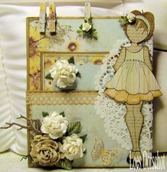 What a cutie!...nice touch with the clothespins...