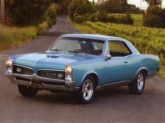 1967 Pontiac GTO This is what our car looked like. It was a 4 speed stick! I learned to drive in that car! Memories!!! :-)