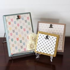 Inexpensive wood plaques from the craft store can be turned into cute frames with scrapbook paper and metallic paint!