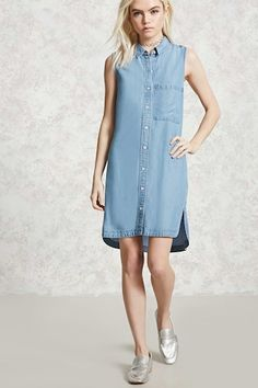 A sleeveless chambray shirt dress featuring a basic collar, a button front closure, a front patch pocket, a back pleat, and a slit hem.