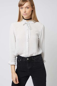 A relaxed striped shirt never goes out of style. Hit refresh on the classic with this ruffle tie-neck style. Equal parts smart and still feminine, try styling with denim for pared-down nonchalance. 100% Polyester. Machine wash.