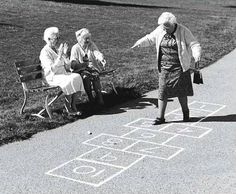 I love this. She's playing Hopscotch and her friends are cheering her on!  TOO cute!