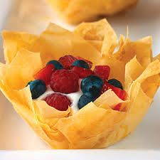 Phyllo pastry shells can be made ahead, stored in airtight containers, and filled with pudding just before serving. Pastries Images, Instant Pudding Mix, Pastry Shells, Phyllo Dough, Whipped Topping, Pastry Recipes, Mousse, Blueberry, Raspberry