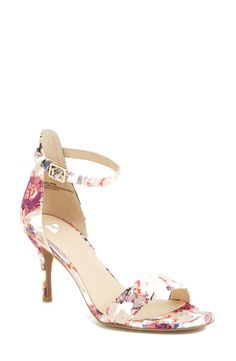 Wearing these floral sandals with a pink fit & flare dress.