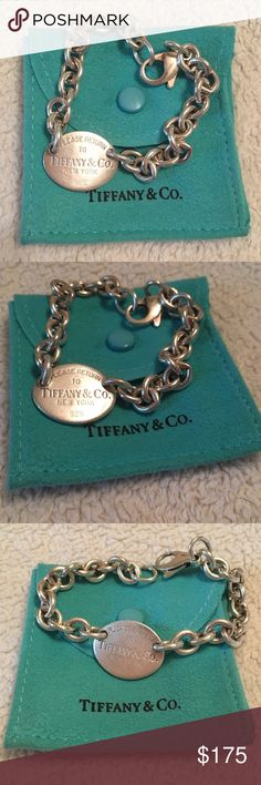 Tiffany & Co Return to Tiffany Oval Tag Bracelet The classic Tiffany & Co Return to Tiffany Oval Tag bracelet in excellent condition that includes the classic blue Tiffany & Co jewelry pouch as pictured above. Tiffany & Co. Jewelry Bracelets