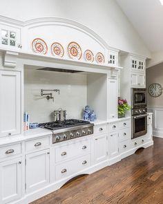 Kitchen Hood. Large Kitchen Hood. Kitchen hoodwinth plates on mantel. #Kitchen #KitchenHood Kim E Courtney Interiors & Design Inc.