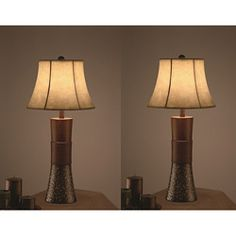 @Overstock - Set includes two table lamps  Setting: Indoor   Fixture finish: Transparent polyresin/metal  http://www.overstock.com/Home-Garden/Metropool-30-inch-Table-Lamps-Set-of-2/6264912/product.html?CID=214117 $146.99