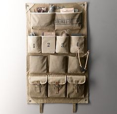 RH Baby & Child's Distressed Canvas Wall Storage:Turn any wall into a stowaway spot with our pocketed wall storage. A vintage military sleeping bag, with all its pockets and compartments, served as the design inspiration for this versatile piece. Boys Army Bedroom, Military Bedroom, Army Room, Gray Bedroom, Teen Bedroom, Vintage Boys, Vintage Nursery, Vintage Style, Army Decor