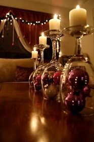Upside down wine glass + ornaments + candle on top