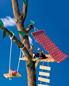 High up on a branch, a tree hotel made of popsicle sticks is the perfect structure to add to your stick village.