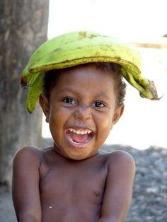 laughing kid from irian jaya