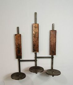 mid century brutalist candle sconce