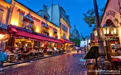 restuarant photos | People at the terrace of cafe le Sabot Rouge enjoying the view of ...