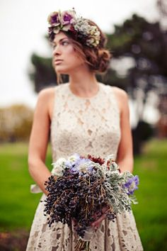 interesting bouquet. nice hair too. loose bun to the side.