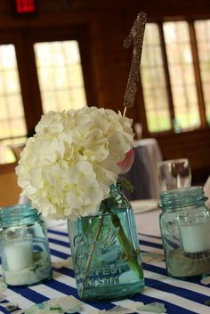 Table decor at our wedding. Rustic with blue mason jars.