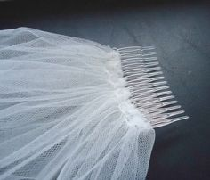 DIY wedding veil. Tulle, two rows of thread on the sewing machine, gather it up, sew it to the comb, (in brief) veil.