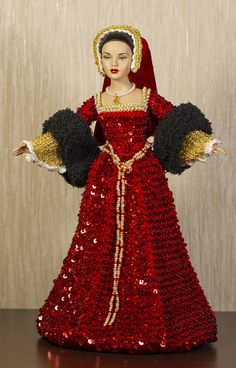 "This Queen's Anne Boleyn dress is crocheted with red sequins. Dress is made with red cotton thread. Under sleeves and neckline are crocheted with golden polyester thread and decorated with pearls. Sleeves are knitted with black ""fur"" thread. Barbie Gowns, Barbie Dress, Barbie Clothes, Historical Women, Historical Photos, Renaissance Gown, Bride Dolls, Viking Woman, King Henry"