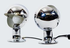 http://www.moderntimes.com.au/shop/lighting/table-lamps/pair-of-chrome-eyeball-table-lamps.phps