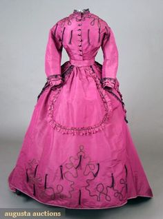 1869 silk Day Dress: 2-piece magenta silk faille, trimmed w/looped black braid, jet buttons, and black silk tassels.  Bodice w/polonaise back.  Augusta Auction's states this is Nellie Grant's dress. Nellie Grant (1855-1922) was the third child and only daughter of U.S. President Ulysses S. Grant and First Lady Julia Grant.  She would have been 14 in 1869.
