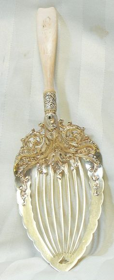 "treasures-and-beauty: ""Whiting pie server, sterling silver and ivory, "" Sterling Silver Flatware, Silver Spoons, Silver Plate, Silver Ring, Sterling Silverware, 925 Silver, Silver Earrings, Art Nouveau, Vintage Silver"