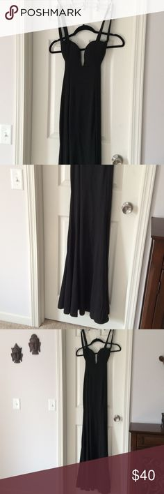 Black dress Long black dress, backless. Never worn. It'll be best if you're tall. It will drag on the floor regardless. Dresses Backless