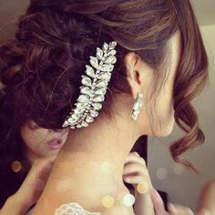 Wedding updo held with beautiful pin and curly bangs - reminds me of Lady Mary's hair pin from Downton Abbey