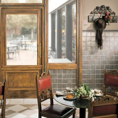 """Saxon Metals in Iron 4 1/4"""" x 4 1/4"""" field tile and Arbour accent, 1"""" x 12"""" Torello and 2"""" x 12"""" chair rail. Tumbled Stone Botticino and Mocha 12"""" x 12"""" shown on floor."""