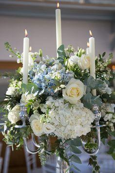 Candelabra centrepiece- pale blue and white wedding flowers - http://www.especiallyamy.co.uk