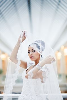 Wedding Hairstyle Top bun with lace edged cathedral length veil