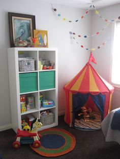 Ikea tent in corner with rainbow colored confetti above tent Circus Room, Circus Nursery, Alphabet Nursery, Yellow Nursery, Nursery Neutral, Conservatory Playroom, Toy Rooms, Creative Kids, Child Room